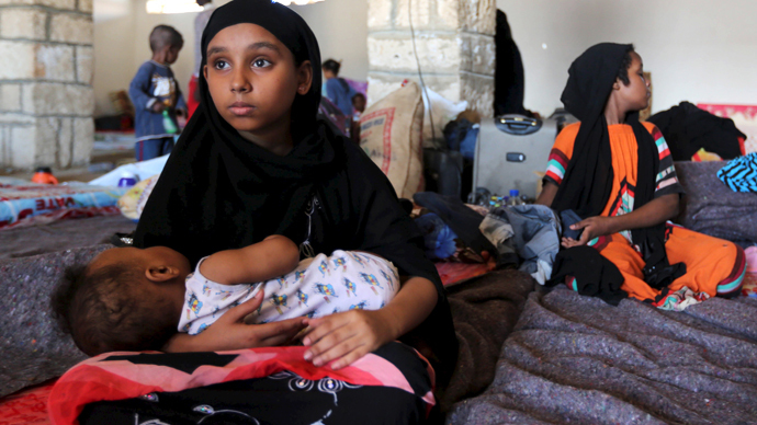 A Yemeni girl holds a baby in a temporary shelter after fleeing violence in Yemen, at the port town Bosasso in Somalia's Puntland (Reuters / Feisal Omar)