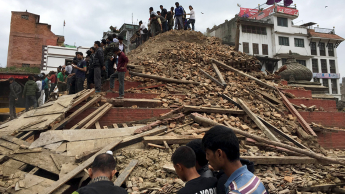 People survey a site damaged by an earthquake, in Kathmandu, Nepal, April 25, 2015. (Reuters / Navesh Chitrakar)