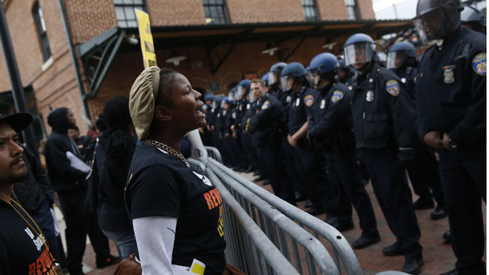Police stand guard outside Camden Yards as protesters gather for a rally to protest the death of Freddie Gray who died following an arrest in Baltimore, Maryland April 25, 2015. (Reuters/Shannon Stapleton)
