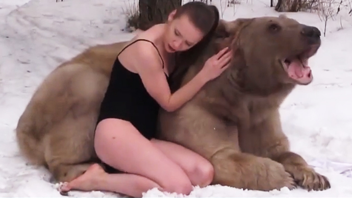 Russian swimsuit models get 'up, close & personal' with 650kg bear
