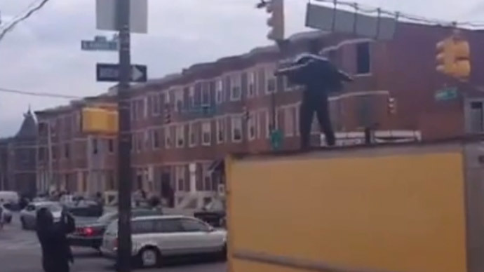 #FreddieGray supporter in Baltimore performs Michael Jackson hit to tell police 'Just Beat It'