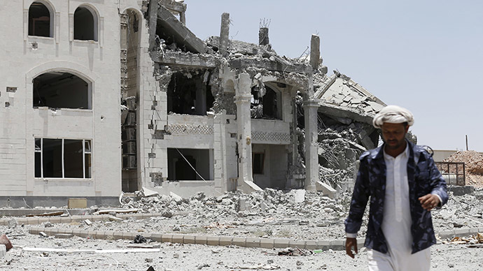 A Houthi militant walks at the yard of residence of the military commander of the Houthi militant group, Abdullah Yahya al Hakim, after an air strike destroyed it, in Sanaa April 28, 2015. (Reuters/Khaled Abdullah)