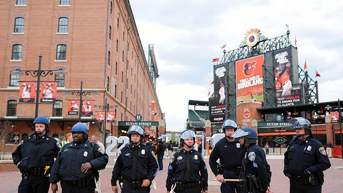 Baltimore police officers stand outsideOriole Park at Camden Yards prior to the cancellation of Monday's game between the Chicago White Sox and Baltimore Orioles (Reuters/Evan Habeeb-USA TODAY Sports)