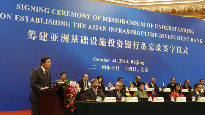 China's Finance Minister Lou Jiwei (L) gives a speech with the guests of the signing ceremony of the Asian Infrastructure Investment Bank at the Great Hall of the People in Beijing October 24, 2014. (Reuters/Takaki Yajima)