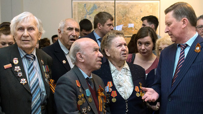 Head of Staff of the Presidential Executive Office Sergei Ivanov (right) and war veterans at the opening of the Victory Exhibition timed to the 70th Victory in the Great Patriotic War in Moscow's Historical Museum. (RIA Novosti/Iliya Pitalev)