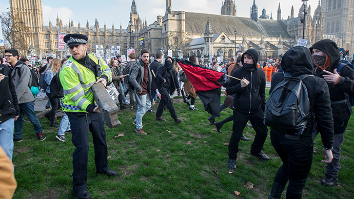 Demonstrators protest in Parliament Square in front of the Houses of Parliament. (Reuters / Peter Nicholls)