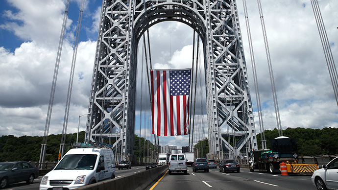 A giant American flag hangs from the West tower of the George Washington Bridge in between New York and New Jersey (Reuters / Mike Segar)