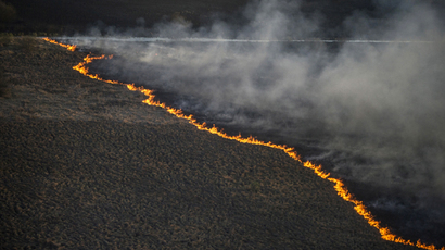 An aerial view from a helicopter shows fire on the ground in northern Ukraine (Reuters / Andrew Kravchenko / Pool)