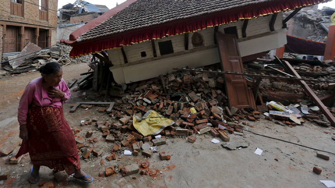 An earthquake victim walks past a collapsed temple in Sankhu, on the outskirts of Kathmandu (Reuters / Adnan Abidi)