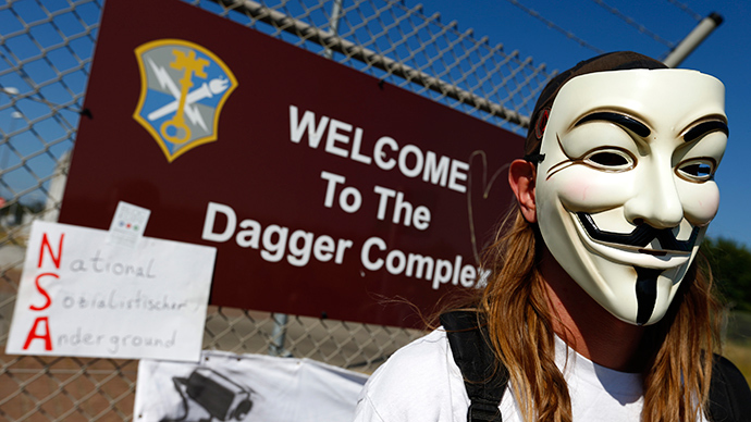 A protester wearing a Guy Fawkes mask protests against NSA in Griesheim,  Germany. (Reuters / Kai Pfaffenbach)
