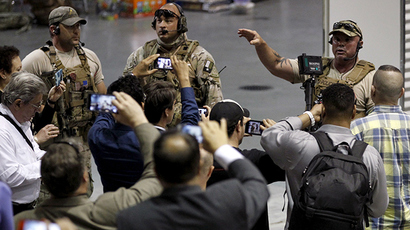 Police officers address attendees at the Mohammed Art Exhibit and Contest after they are prevented from leaving when it was reported that shots were fired and a man is down in Garland, Texas May 3, 2015 (Reuters / Mike Stone)