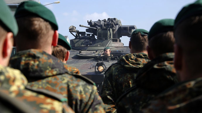 A Marder armoured infantry vehicle drives past German Bundeswehr armed forces soldiers of the 371st armoured infantry battalion during a media day of the NATO drill 'NOBLE JUMP 2015' at the barracks in Marienberg April 10, 2015. (Reuters/Fabrizio Bensch)