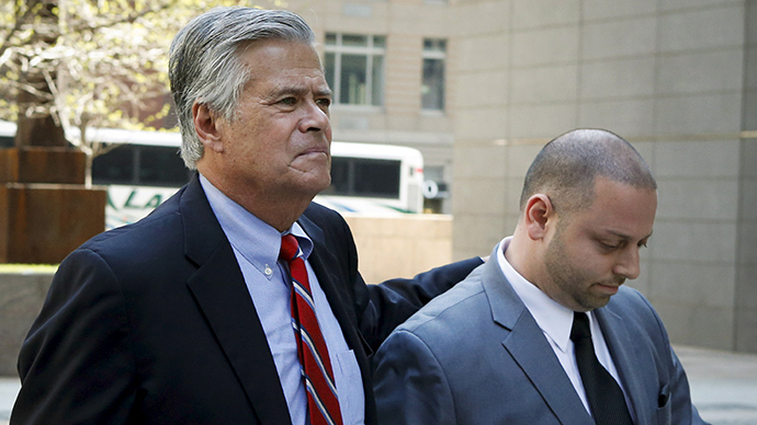 New York State Senator Dean Skelos (L) hugs his son Adam Skelos while they arrive at the Jacob Javits Federal Building in New York May 4, 2015 (Reuters / Eduardo Munoz)