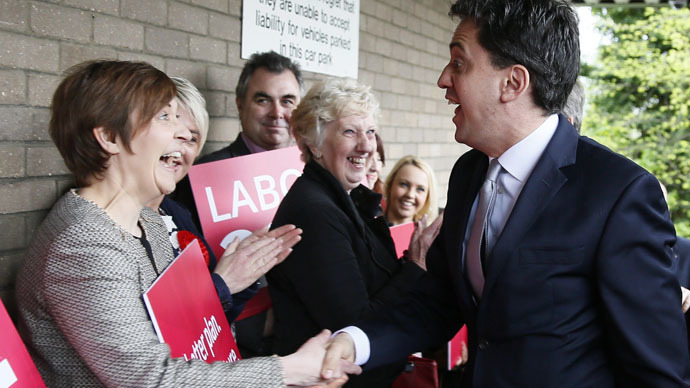 Britain's opposition Labour Party leader Ed Miliband (R) arrives to host a People's Question Time in Kempston, Britain May 5, 2015. (Reuters/Stefan Wermuth)