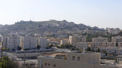 A view of Pisgat Ze'ev (front), an urban settlement in an area Israel annexed to Jerusalem after capturing it in the 1967 Middle East war, and the Arab neighbourhood of Beit Hanina (rear) is seen in East Jerusalem December 7, 2014. (Reuters/Ammar Awad)