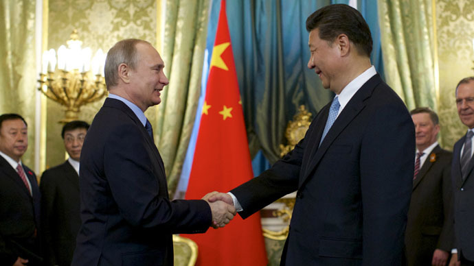 Russia's President Vladimir Putin (L) shakes hands with China's President Xi Jinping during their meeting at the Kremlin in Moscow, Russia May 8, 2015. (Reuters/Alexander Zemlianichenko)