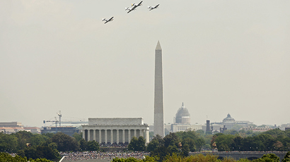 "P51-Mustangs take part in the ""Arsenal of Democracy World War II Victory Capitol Flyover"" to commemorate the 70th anniversary of VE (Victory in Europe) Day (Reuters/Kevin Lamarque)"