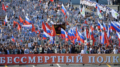 Participants during the march of the Immortal Regiment Moscow regional patriotic public organization on Red Square. (RIA Novosti/Vladimir Pesnya)