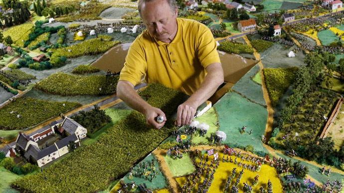 Waterloo enthusiast Willy Smout, 56, adjusts figurines on a 40-square-metre miniature model of the June 18, 1815 Waterloo battlefield, in Diest, Belgium, in this picture taken on April 29, 2015. (Reuters/Francois Lenoir)