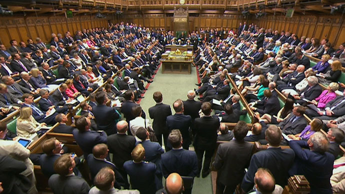 Members of Parliament are seen attending a session of Parliament in the House of Commons in London. (Reuters/UK Parliament via Reuters TV)
