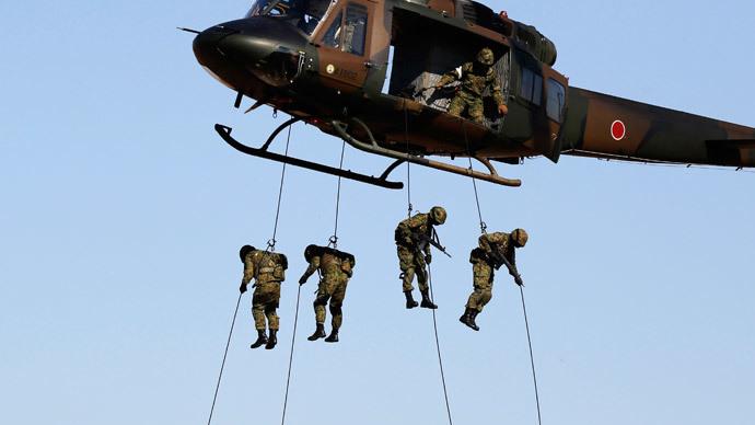 Japan's cabinet approves legislation expanding military powers