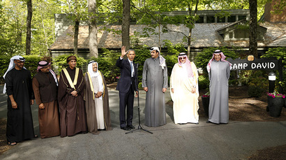 U.S. President Barack Obama takes part in a group photo after hosting the six-nation Gulf Cooperation Council (GCC) at Camp David in Maryland May 14, 2015. (Reuters/Kevin Lamarque)