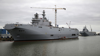 The two Mistral-class helicopter carriers Sevastopol (L) and Vladivostok are seen at the STX Les Chantiers de l'Atlantique shipyard site in Saint-Nazaire, western France, December 23, 2014. (Reuters/Stephane Mahe)