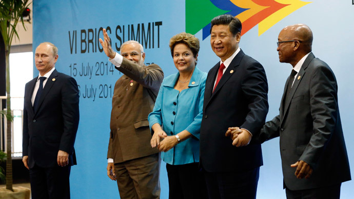 (L-R) Russia's President Vladimir Putin, India's Prime Minister Narendra Modi, Brazil's President Dilma Rousseff, China's President Xi Jinping and South Africa's President Jacob Zuma prepare to pose for a group picture during the VI BRICS Summit in Fortaleza July 15, 2014.(Reuters / Paulo Whitaker)