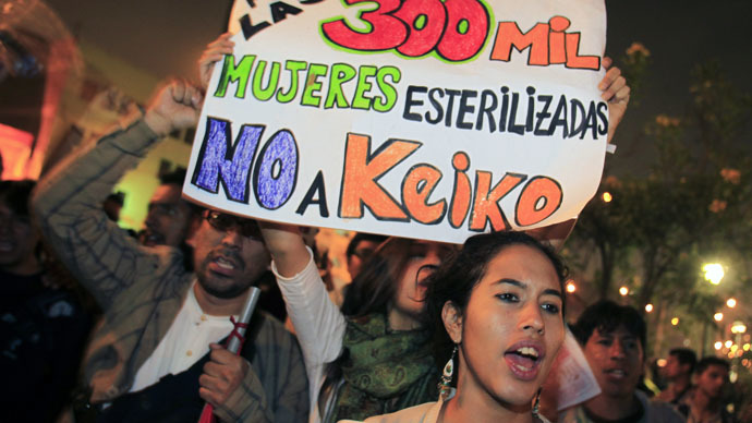 People hold a sign reading: 'For the 300,000 sterilized women, no to Keiko', referring to the sterilization of thousands of Andean women during the former Peru's president Alberto Fujimori's government, during a protest against Peru's presidential candidate Keiko Fujimori in Lima, May 20, 2011. (Reuters/Pilar Olivares)
