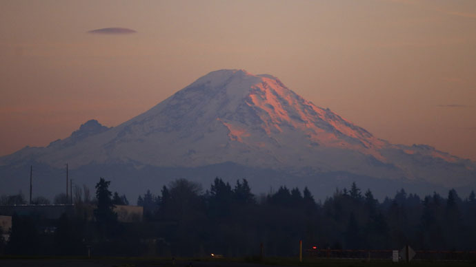 Mount Rainier is pictured as the last rays of sunlight hit its western side, taken from the tarmac of Seattle Airport (Reuters/Jason Reed)