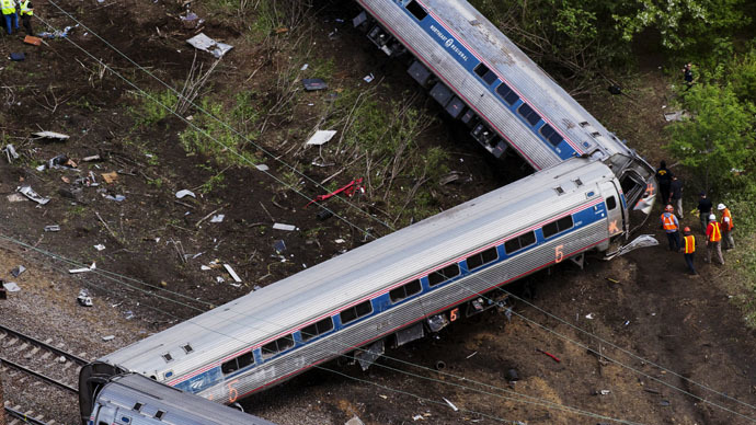 Emergency workers and Amtrak personnel inspect a derailed Amtrak train in Philadelphia, Pennsylvania May 13, 2015. (Reuters/Lucas Jackson)