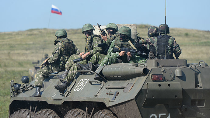 Russian servicemen on a BTR-80. (RIA Novosti/Pavel Lisitsyn)