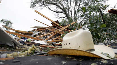 A cowboy hat lies among the debris of destroyed homes after a tornado swept through the area the previous night in Van, Texas May 11, 2015.(Reuters / Mike Stone)