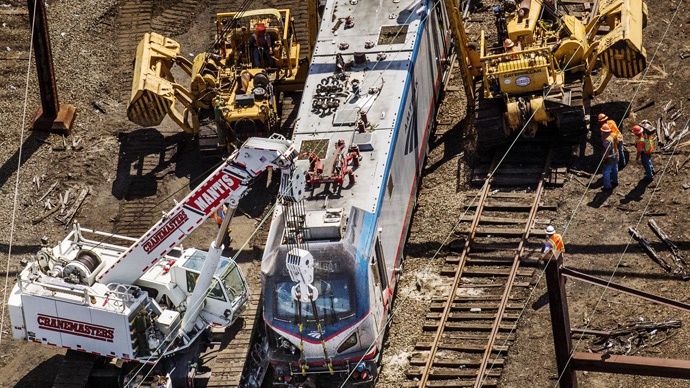 Emergency workers inspect the engine of a derailed Amtrak train in Philadelphia, Pennsylvania May 13, 2015. (Reuters / Lucas Jackson)