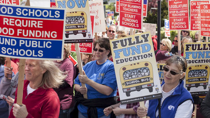Teachers from the Arlington School District and other districts are joined by students and community members while staging a walkout in Arlington, Washington, April 22, 2015. (Reuters/David Ryder)