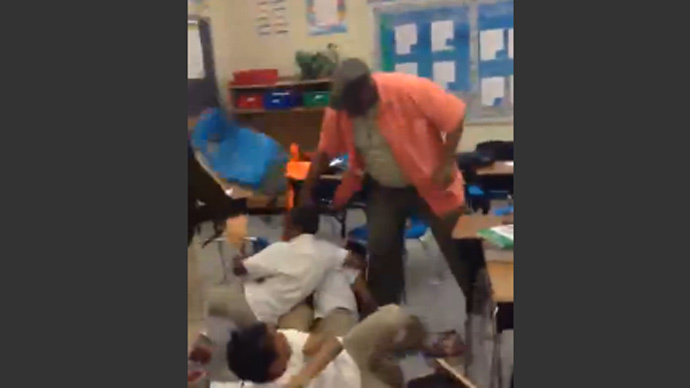 video of substitute teacher hitting students with belt