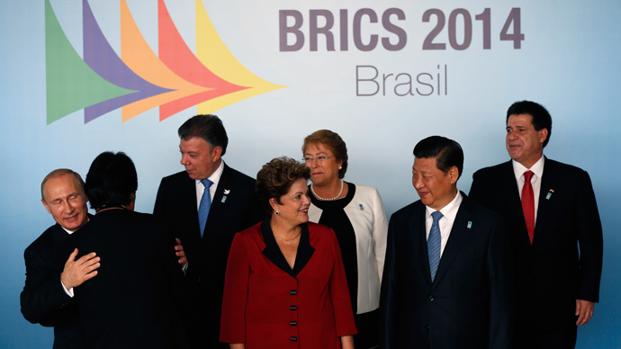 ARCHIVE PHOTO: Russia's President Vladimir Putin (L-R), Bolivia's President Evo Morales, Colombia's President Juan Manuel Santos, Brazil's President Dilma Rousseff, Chile's President Michelle Bachelet, China's President Xi Jinping and Paraguayan President Horacio Cartes talk at a group photo session during the 6th BRICS summit and the Union of South American Nations (UNASUR) in Brasilia July 16, 2014. (Reuters / Ueslei Marcelino)