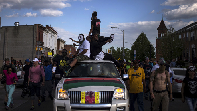 Residents march through the streets of west Baltimore, Maryland (Reuters / Adrees Latif)