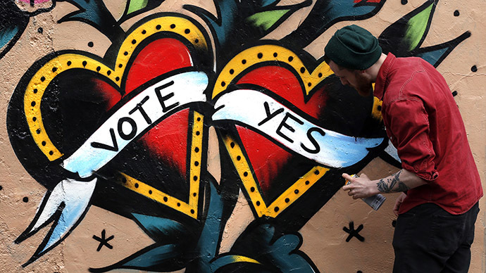 A graffiti artist finishes a Yes campaign piece in central Dublin in Ireland May 20, 2015. (Reuters/Cathal McNaughton)