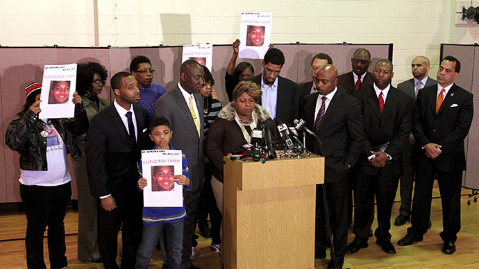 Samaria Rice, the mother of Tamir Rice, the 12-year old boy who was fatally shot by police last month while carrying what turned out to be a replica toy gun, speaks while surrounded by attorneys, local leaders and family during a news conference at the Olivet Baptist Church in Cleveland, Ohio December 8, 2014. (Reuters/Aaron Josefczyk)