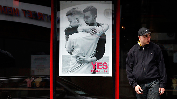 A restaurant displays a poster supporting the Yes vote, in the Caple Street area of Dublin in Ireland (Reuters / Cathal McNaughton)