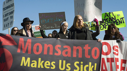 Activists protest against the production of herbicides and GMO (genetically modified organisms) food products outside Monsanto headquarters during its annual shareholders meeting in Creve Coeur, Missouri, January 30, 2015. (Reuters/Kate Munsch)