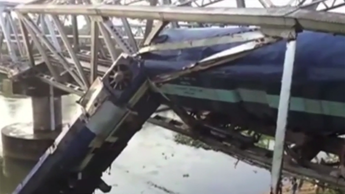 Train derails while navigating bridge in India, multiple injuries (VIDEO)