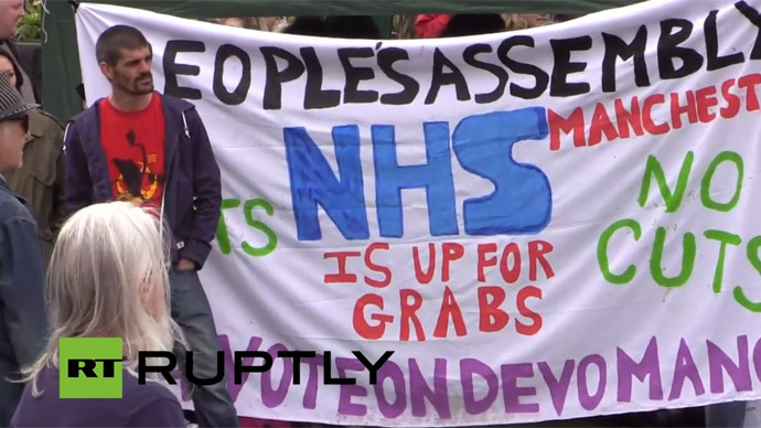 ​'No more austerity': Demonstrators gather in Manchester to protest cuts, Tory govt