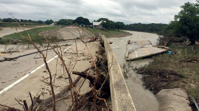 This May 24, 2015 Handout photo provided by the Blanco Police Department in Blanco, Texas shows the bridge on Rte 165 spanning the Blanco River that was washed away by flash flooding caused by torrential downpours. (AFP/BLANCO POLICE DEPARTMENT)