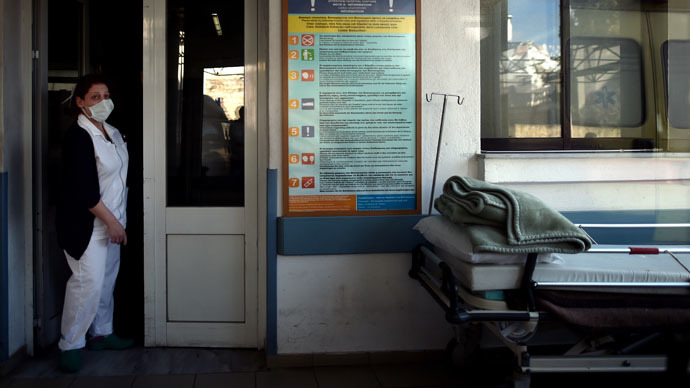 A nurse stands in a doorway at a hospital on the eastern Greek island of Samos (AFP Photo/Aris Messinis)