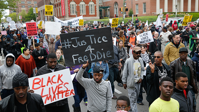 Protesters are gathered for a rally to protest the death of Freddie Gray who died following an arrest in Baltimore, Maryland (Reuters / Shannon Stapleton)