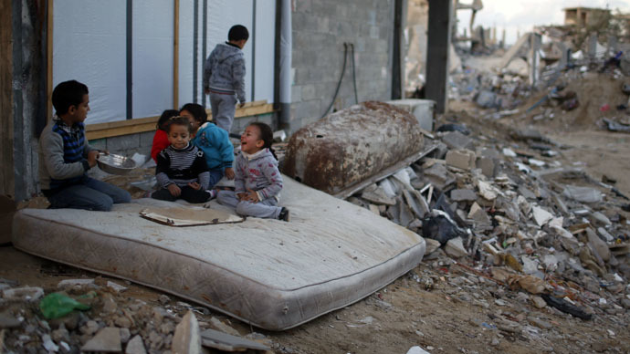 Palestinian children play on a mattress near the ruins of houses which witnesses said were destroyed by Israeli shelling during the most recent conflict between Israel and Hamas, in the east of Gaza City (Reuters/Mohammed Salem)