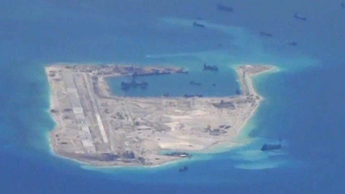 Chinese dredging vessels are purportedly seen in the waters around Fiery Cross Reef in the disputed Spratly Islands in the South China Sea in this still image from video taken by a P-8A Poseidon surveillance aircraft provided by the United States Navy May 21, 2015. (Reuters/U.S. Navy)