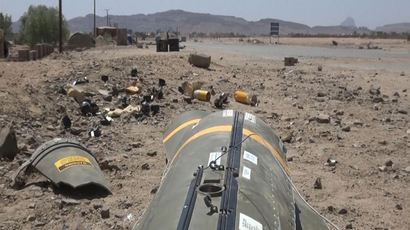 Remnants of an air-dropped cluster munition and unexploded BLU-97 submunitions found in the al-Nushoor and al-Maqash areas of Yemen's northern Saada governorate on May 23, 2015. (image from www.hrw.org)
